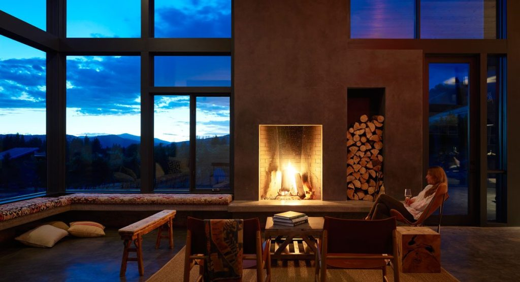 The warmth of the interior welcomes visitors to the winery in all seasons. Photographer: Kevin Scott