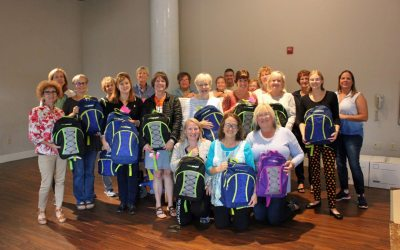 AAMA and World Vision fill 500 backpacks with supplies for in-need children