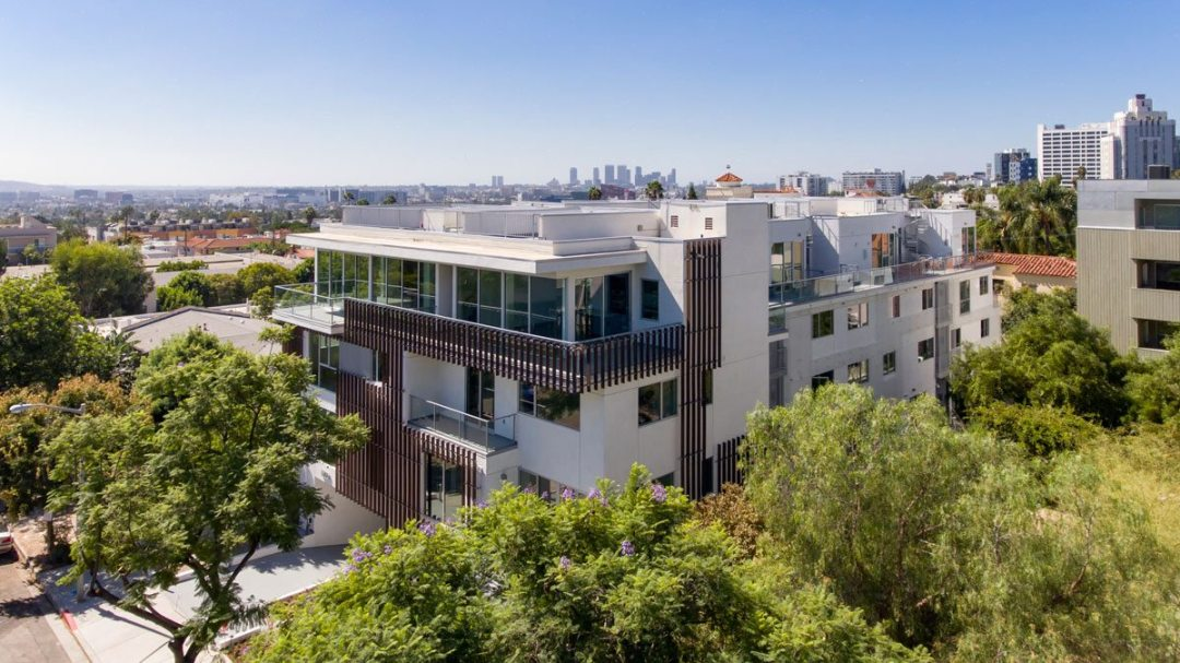 16 contemporary townhomes set amidst the stunning backdrop of the Hollywood Hills. Credit: Scott Evertz