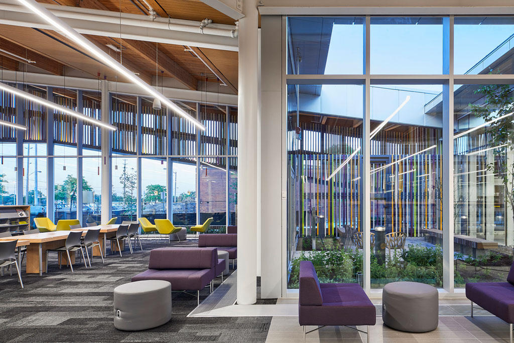 Space flows between interior program areas and exterior courtyards. Glazed terracotta screens bring color to the library interior. Image: Doublespace Photography