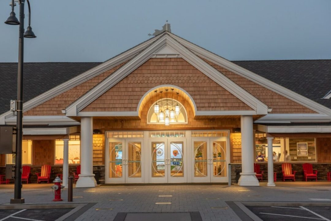 The exterior design of the Long Island Welcome Center was inspired by Long Island's historic grand estates. The design incorporates a shingle-style portico entrance with arched openings framing an ornamental window, expansive doors, and a large welcoming porch. Courtesy of Stantec