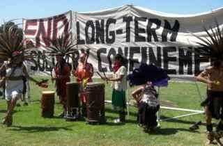 Aztec dancers in front of banner