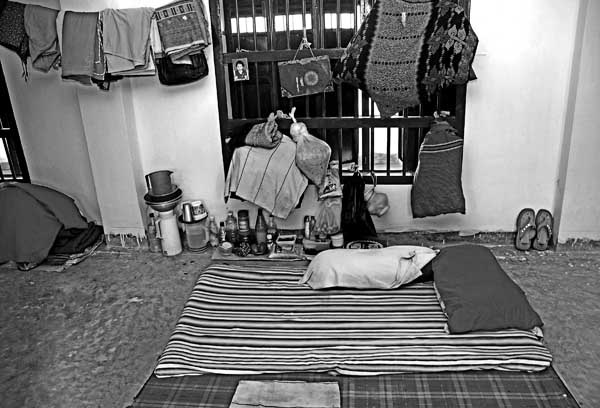 """Cell, Momena Jalil, 2008. Having spent a year in prison already, 25-year-old Rahima still cannot reconcile with her living conditions. """"The air, the walls, the people, the place- all of it has been a shock for me"""", she says. She struggles to wear the blank and emotionless expression that the rest of her inmates wear every day, yet every time she speaks of her experience in jail, she fights back tears."""