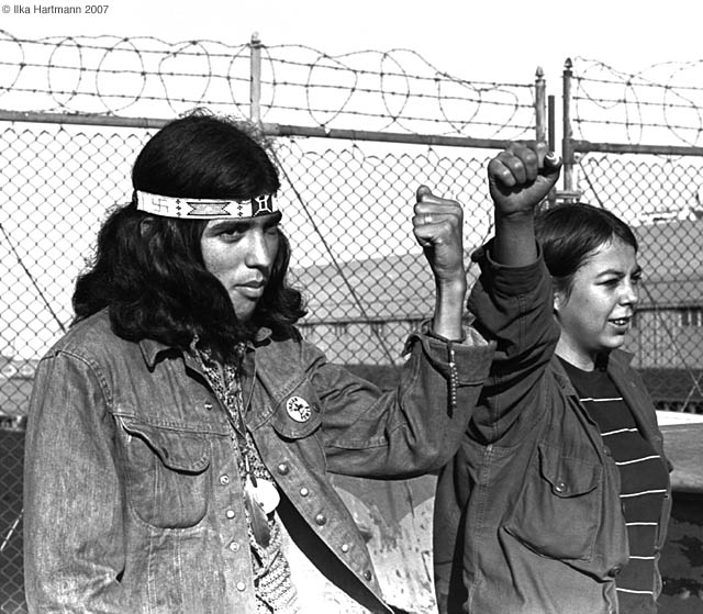 """We will not give up"". Indian occupiers moments after the removal from Alcatraz Island on June 11, 1971. Oohosis, a Cree from Canada (Left) and Peggy Lee Ellenwood, a Sioux from Wolf Point, Montana (Right). Photo Ilka Hartmann"