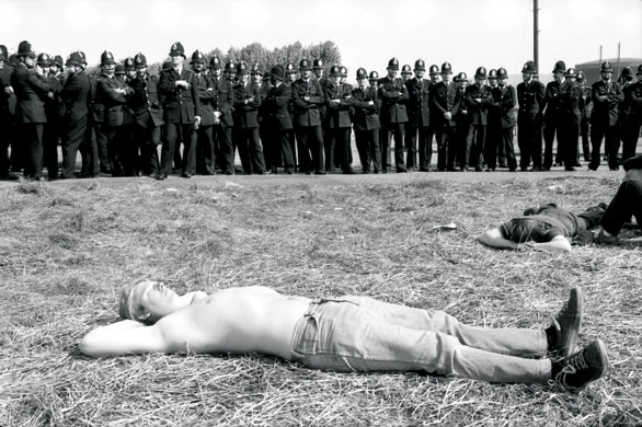 Miners sunbathing at Orgreave coking plant. Photograph: Don McPhee