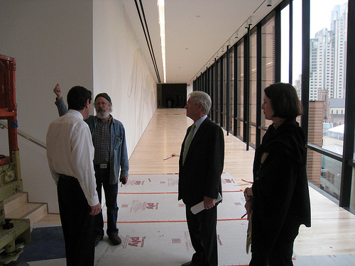 Neal talking with Exhibitions Design Manager / Chief Preparator Kent Roberts. With Chuck Schwab, chairman of the board of trustees (center) and Catherine Kuuskraa (right). In the background on the left wall you can just slightly see the new bridge commission, by Rosana Castrillo-Diaz.