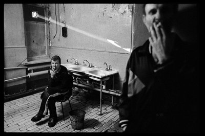 TB patients smoke cigarettes in the smoking room of Tomsk Regional Clinical Tuberculosis Hospital, Building #1. James Nachtwey/VII
