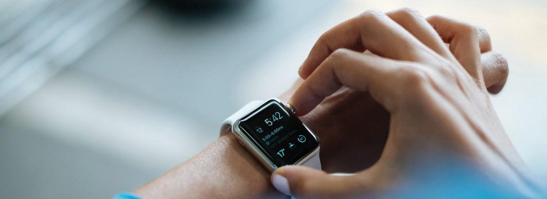 person adjusting smart watch