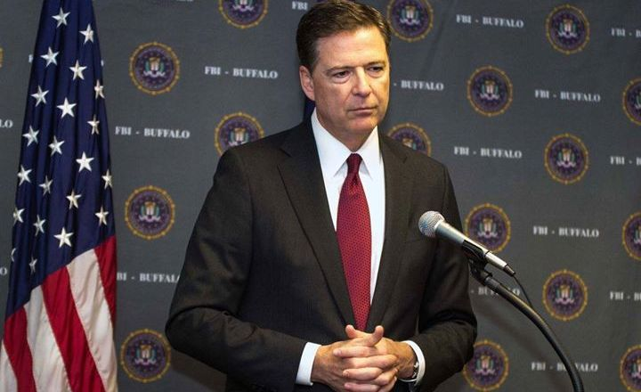 James Comey FBI conference with American Flag