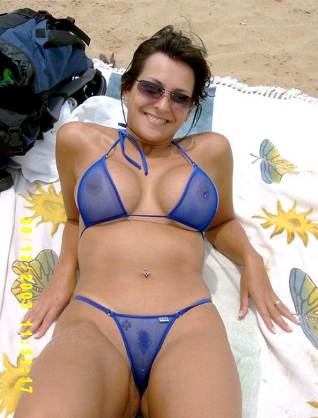 This Hot Milf Makes Sure Shes Always Looking Hot Thats Why She Tans In Such A Tiny Bikini Seriously Theres Not Much To It Its Pretty Much See Through