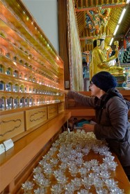 Cleaning the year-prayer candles