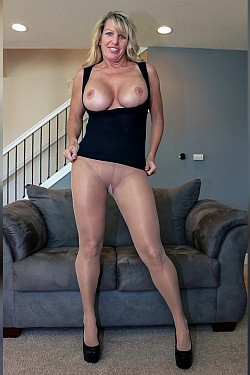 Busty Milf Shows Her Strong Legs In Nude Pantyhose