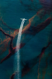Oil Spill #18: A C-130 plane sprays dispersant on oil leaked from the Deepwater Horizon wellhead in the Gulf of Mexico. In all, 2 million gallons of...