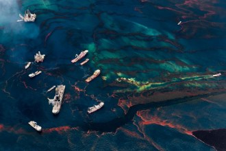 Oil Spill #3: Boats gather near remaining oil platforms by the site of the Deepwater Horizon wellhead, leaving oily wakes as they move through the...