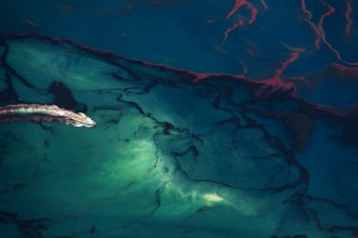 Oil Spill #15: A ship motors through oil spilled in the Gulf of Mexico. The spill caused extensive damage to the marine and wildlife habitats as well...