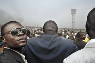 Presidential candidate Jean-Pierre Bemba enters a stadium in central Kinshasa flanked by his bodyguards during an election rally.