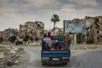 Eissa al-Ali and his family return home to their heavily destroyed neighbourhood in Raqqa, Syria, after years of displacement. The battle to liberate...