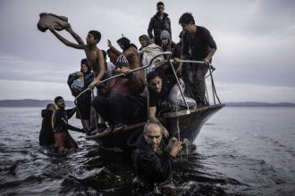 November 16, 2015. Migrants arrive by a Turkish boat near the village of Skala, on the Greek island of Lesbos. The Turkish boat owner delivered some...