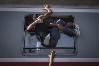 Friday September, 18, 2015. Desperate refugees board the train toward Zagreb at Tovarnik station on the border with Serbia. As key nations tightened...