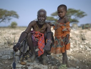 Turkana tribal Elder with traditional spear and club, and his granddaughter, Nakuprat Village, Nakuprat-Gotu Community Conservancy