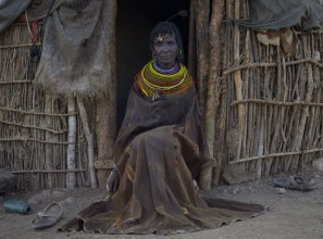 Turkana Elder woman wearing traditional goatskin cloak