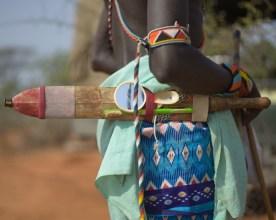 Samburu Moran warrior with beads, traditional knife, hand mirror and plastic toothbrush, Namunyak Wildlife Conservancy