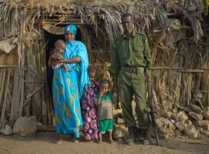 Nakuprat-Gotu Conservancy scout, Hassan Ngodana, and his wife and children, Gotu Village, Nakuprat-Gotu Community Conservancy