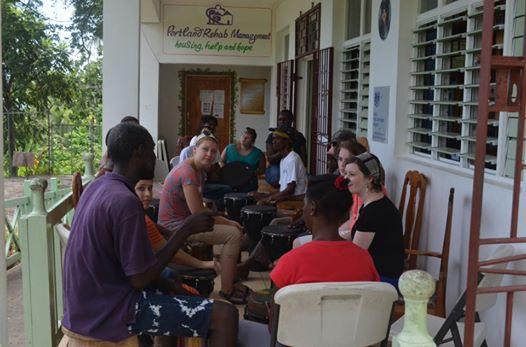 Volunteers teaching drumming lessons