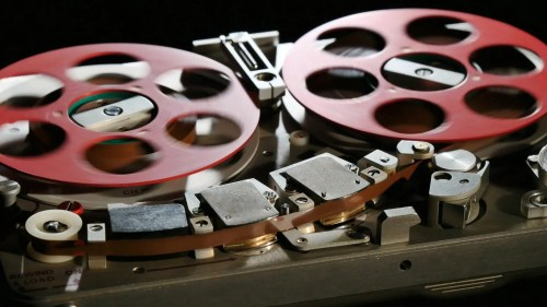 Audio tape recorder close up black-background_ey59uufy_2160__D_Moment