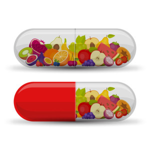 Medical capsule with fruit. Vitamins and supplements. Different