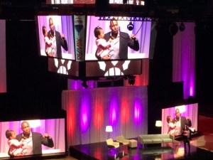 Ujiri on stage at preview (with daughter) by MoVernie