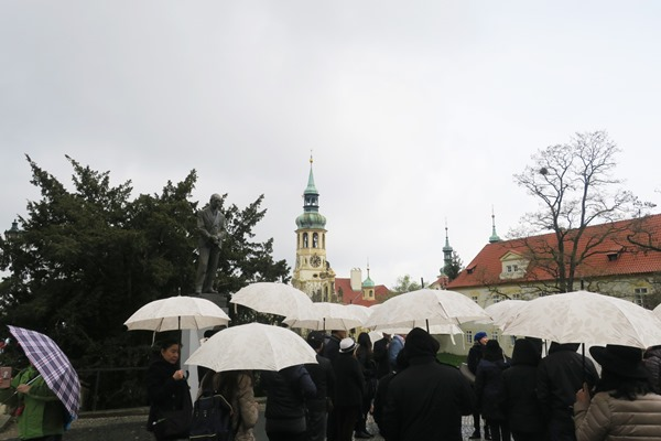 Tour group with umbrellas during Prague Easter Markets