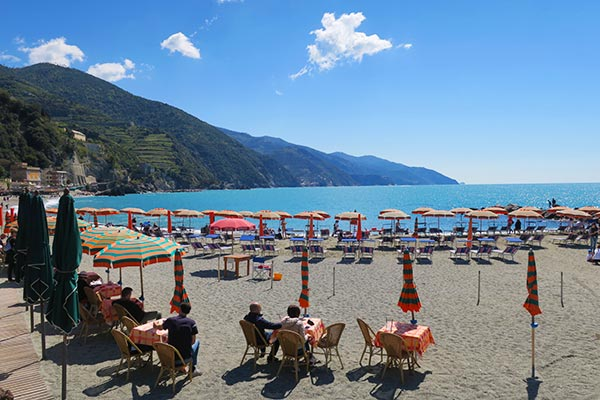 View of the beach at the village of Monterosso El Mare, How to get to Cinque Terre Italy
