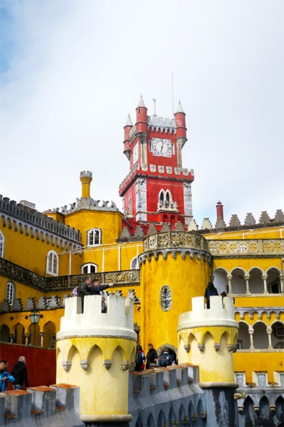 Yellow and red buildings of Pena Palace Sintra Portugal. Images from our 2 day Sintra itinerary