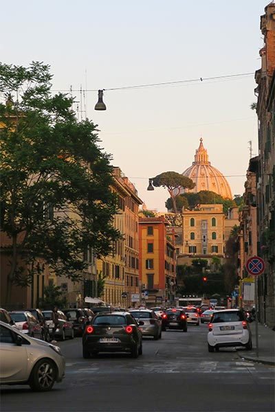 view of the Prati area in Rome at sunset with the Vatican in the background. Prati is a great area to discover food on our food tour in Rome.