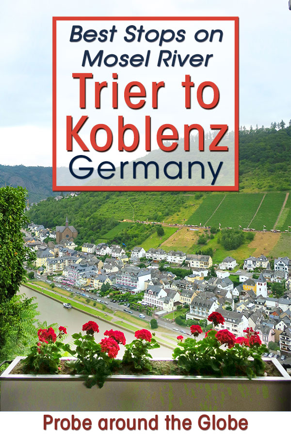 Image of a frames view of the river Mosel from Cochem castle, showing the grey slaighted roofs of Cochem and the river below. Red flowers in the window sill with text overlay saying: Best Stops on Mosel River Trier to Koblenz Germany Probe around the Globe