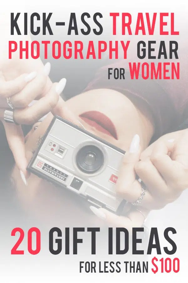 Hazy image of a girl laying on her back white holding a camera in front of her face. Text overlay saying: Kick-Ass Travel Photography Gear for Woman, 20 Gift Ideasfor less than $100 Probe around the Globe