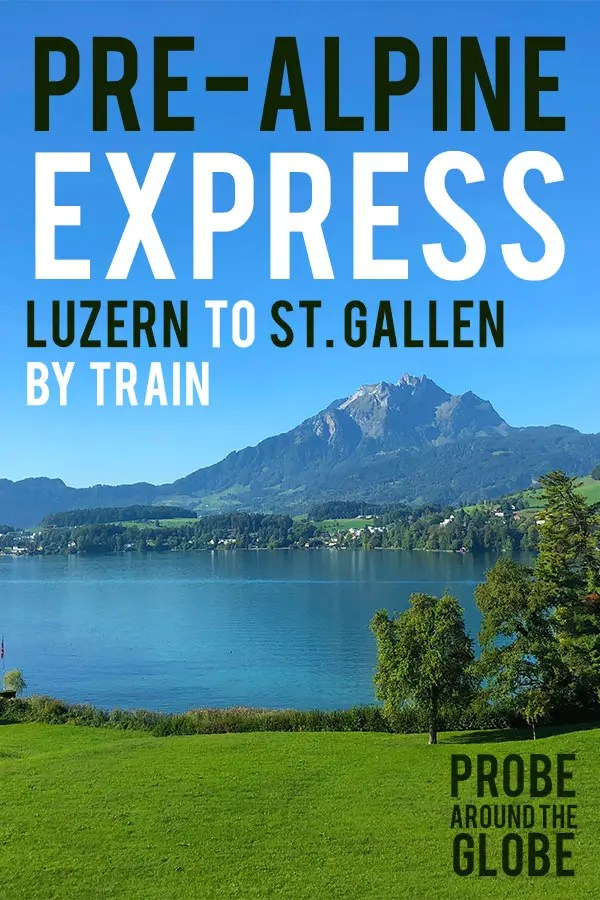 Image of the lake and green hills of the PreAlpine Foothills in Switzerland taking from the Voralpen Express train in Switzerland. Text overlay saying: Pre-Alpine Express Luzern to St. Gallen by Train, Probe around the Globe