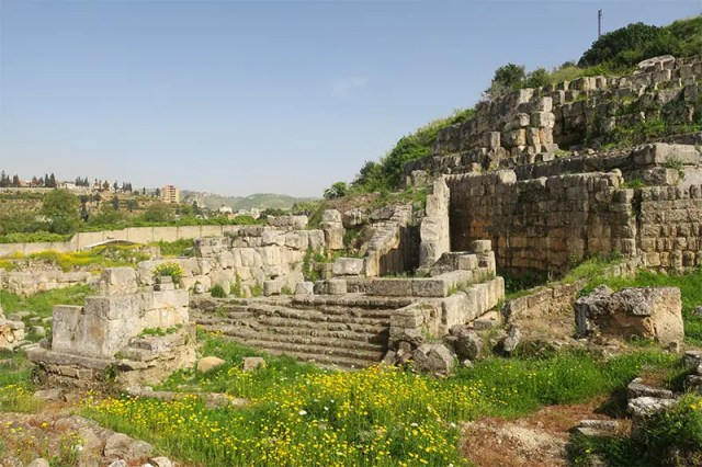 Green remains of the Temple of Eshmun that you can visit on a day trip to Tyre and Sidon from Beirut Lebanon