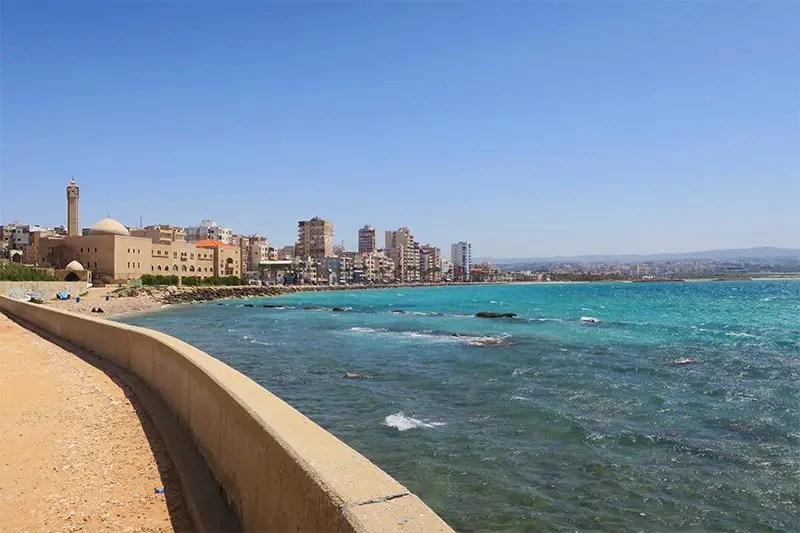 Lovely view on the city of Tyre and the blue sea and sandy beach from the ruins of Tyre.