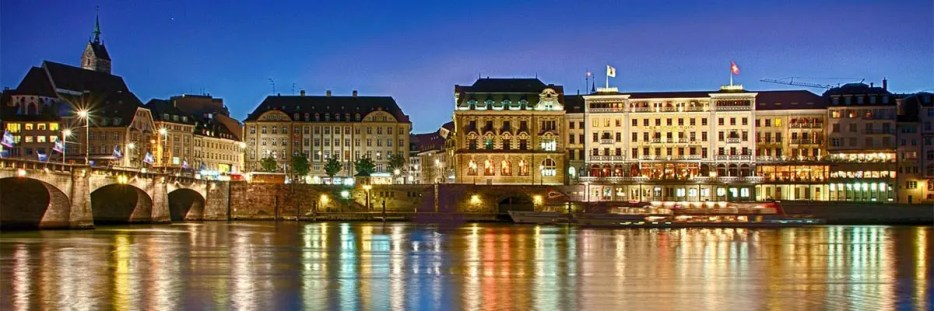 The skyline of Basel, one of the most beautiful cities in Switzerland to visit at night.