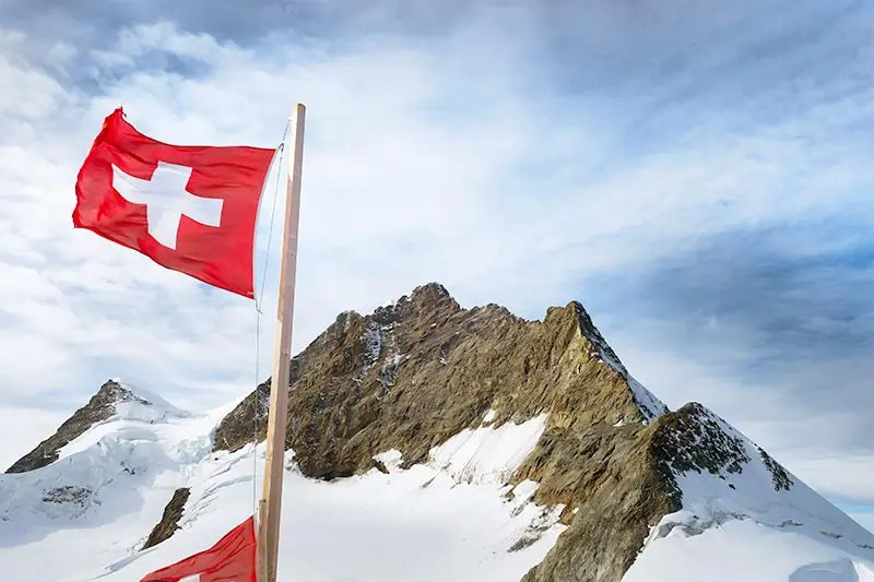 Jungfrau from the Top of Europe Train Station with Swiss flag.