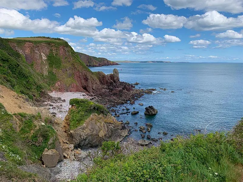 My experience hiking from Manorbier to Bosherston on the Pembrokeshire Coast Path in Wales. Read my practical tips for walking this part of the Wales Coast Path