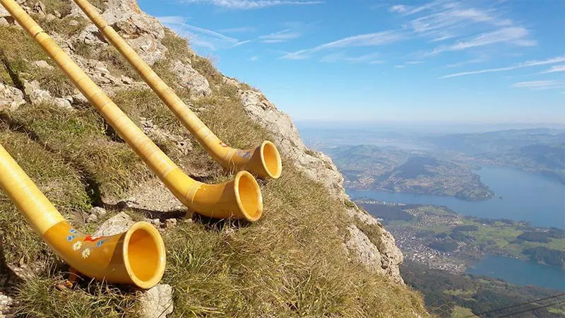 Alp horns on a mountain overlooking Lucerne, one of the most beautiful places in Switzerland to visit.