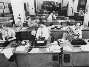 Old photo of The New York Times newsroom.
