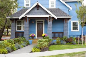 painted blue house with nice small front yard