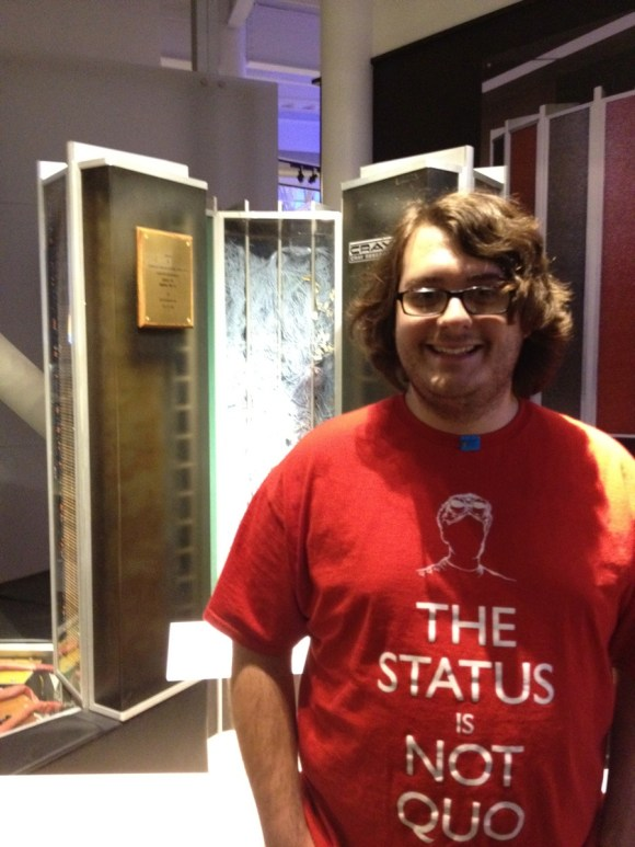 Me wearing a red t-shirt standing in front of a Cray supercomputer