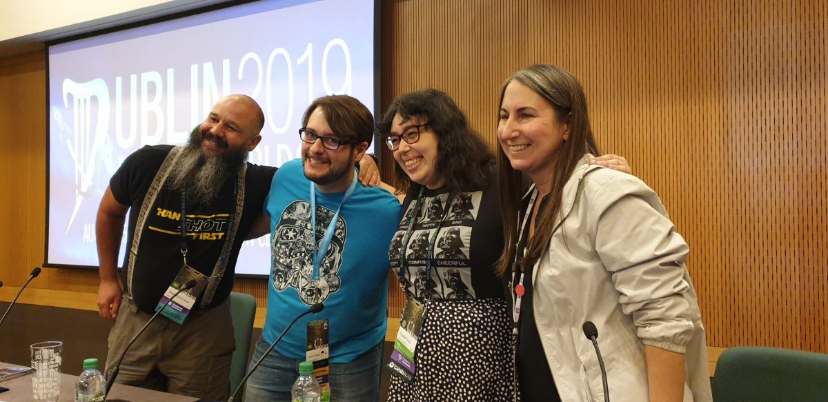 The panellists from the 40 Years of the Force panel, hugging. From left to right, Boaz Karni-Harel, myself, Claudia Fusco, Jackie Kamlot