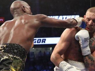 Floyd Mayweather extended his professional record to 50-0