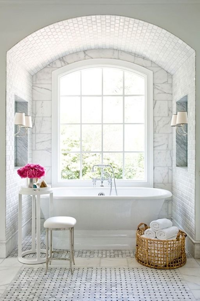 white marble bathroom with freestanding tub
